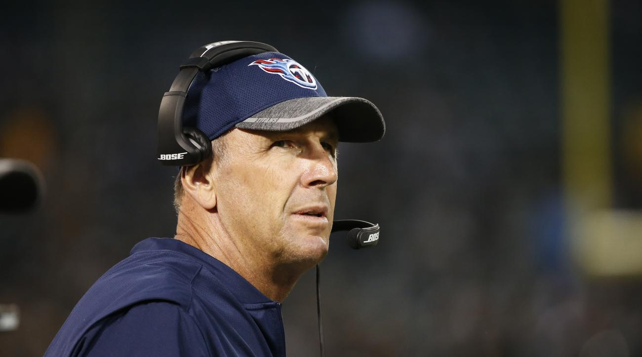 FILE - In this Aug. 27, 2016, file photo, Tennessee Titans head coach Mike Mularkey looks from the sidelines  uring the second half of an NFL preseason football game against the Oakland Raiders, in Oakland, Calif. The Tennessee Titans return from their by