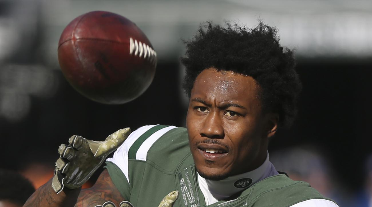 FILE - In this Nov. 13, 2016, file photo, New York Jets wide receiver Brandon Marshall (15) warms up before playing against the Los Angeles Rams, in East Rutherford, N.J. Arizona's Larry Fitzgerald, Miami's Mike Pouncey and the New York Jets' Brandon Mars