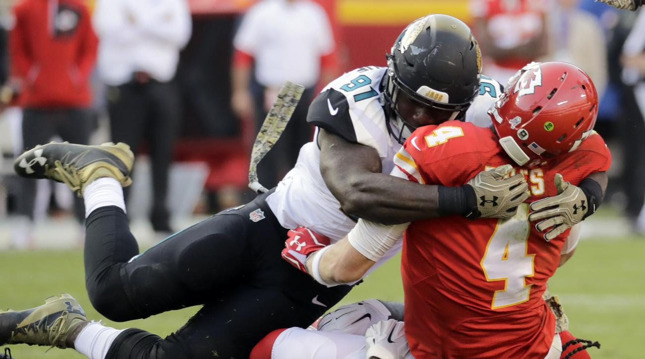 FILE - In this Nov. 6, 2016, file photo, Jacksonville Jaguars defensive tackle Sen'Derrick Marks (99), bottom, and defensive end Yannick Ngakoue (91) sack Kansas City Chiefs quarterback Nick Foles (4) during the second half of an NFL football game in Kans