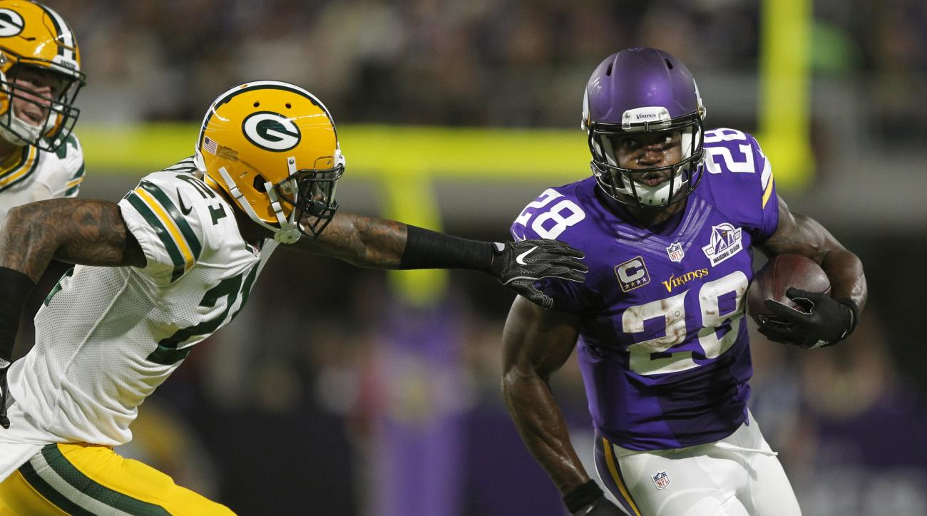 FILE -  In this Sunday, Sept. 18, 2016 file photo, Minnesota Vikings running back Adrian Peterson (28) runs from Green Bay Packers free safety Ha Ha Clinton-Dix, left, during the first half of an NFL football game in Minneapolis. With coach Mike Zimmer ba