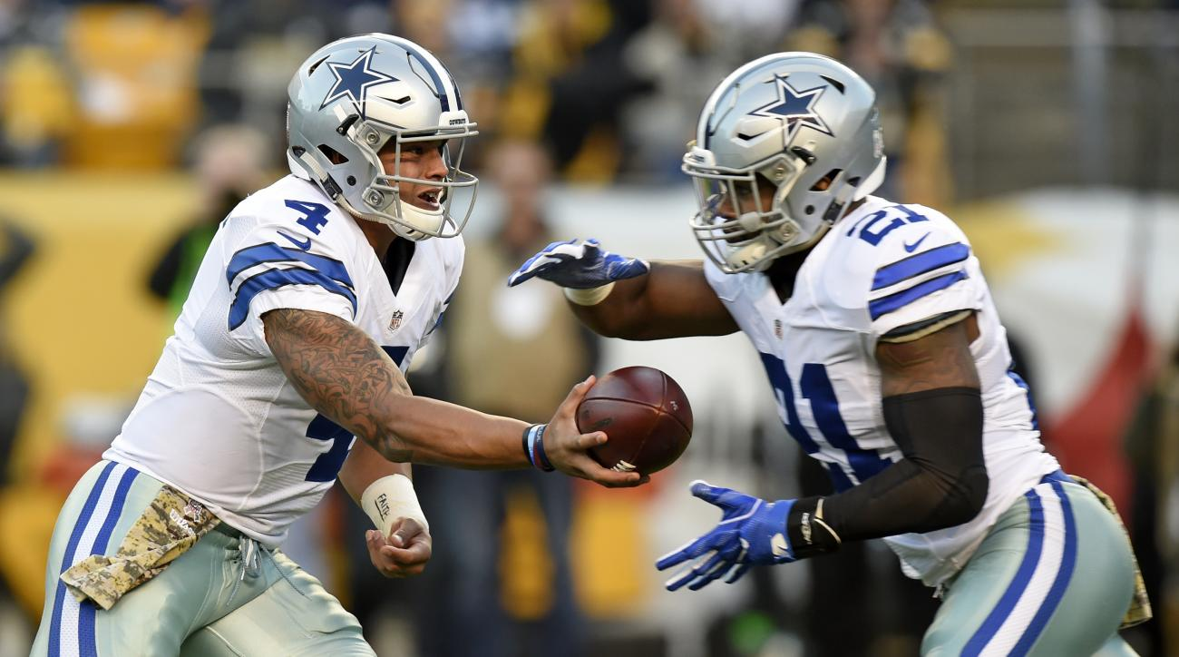 FILE - In this Sunday, Nov. 13, 2016 file photo, Dallas Cowboys quarterback Dak Prescott (4) hands the ball off to running back Ezekiel Elliott (21) during the first half of an NFL football game against the Pittsburgh Steelers in Pittsburgh. Rookie sensat