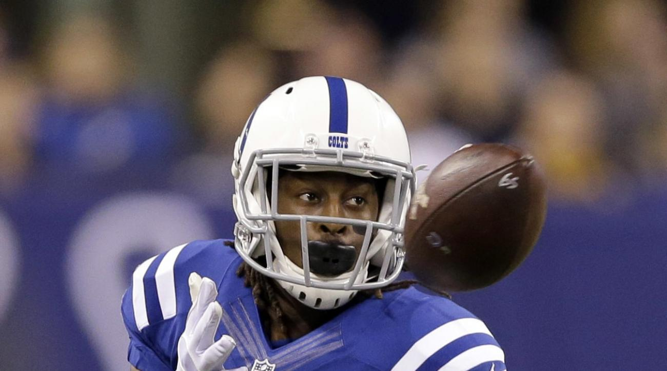 FILE - In this Nov. 24, 2016, file photo, Indianapolis Colts wide receiver T.Y. Hilton catches a pass during the first half an NFL football game against the Pittsburgh Steelers, in Indianapolis. The Colts take on the texans in Indianapolis on Sunday. Nobo