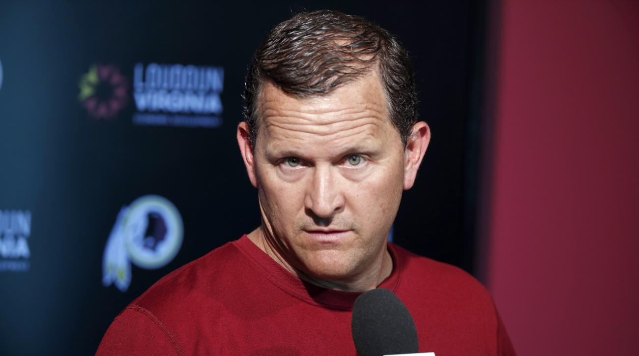 In this photo taken June 1, 2016, Washington Redskins defensive coordinator Joe Barry listens to a question during news conference at the team's NFL football training facility at Redskins Park, in Ashburn, Va. No team in the NFL is worse on third down tha
