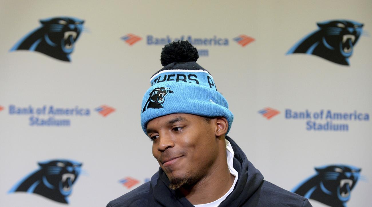 Carolina Panthers NFL football quarterback Cam Newton speaks to the media following practice, Thursday, Dec. 8, 2016, in Charlotte, N.C.  (Jeff Siner/The Charlotte Observer via AP)