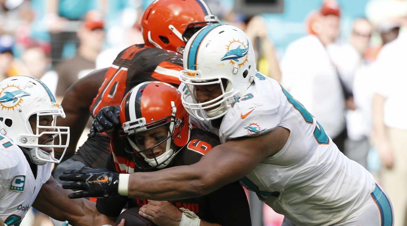 FILE - In this Sept. 25, 2016, file photo, Cleveland Browns quarterback Cody Kessler (6) is sacked by Miami Dolphins defensive tackle Ndamukong Suh (93) during overtime at an NFL football game,in Miami Gardens, Fla. The Arizona Cardinals take on the Miami