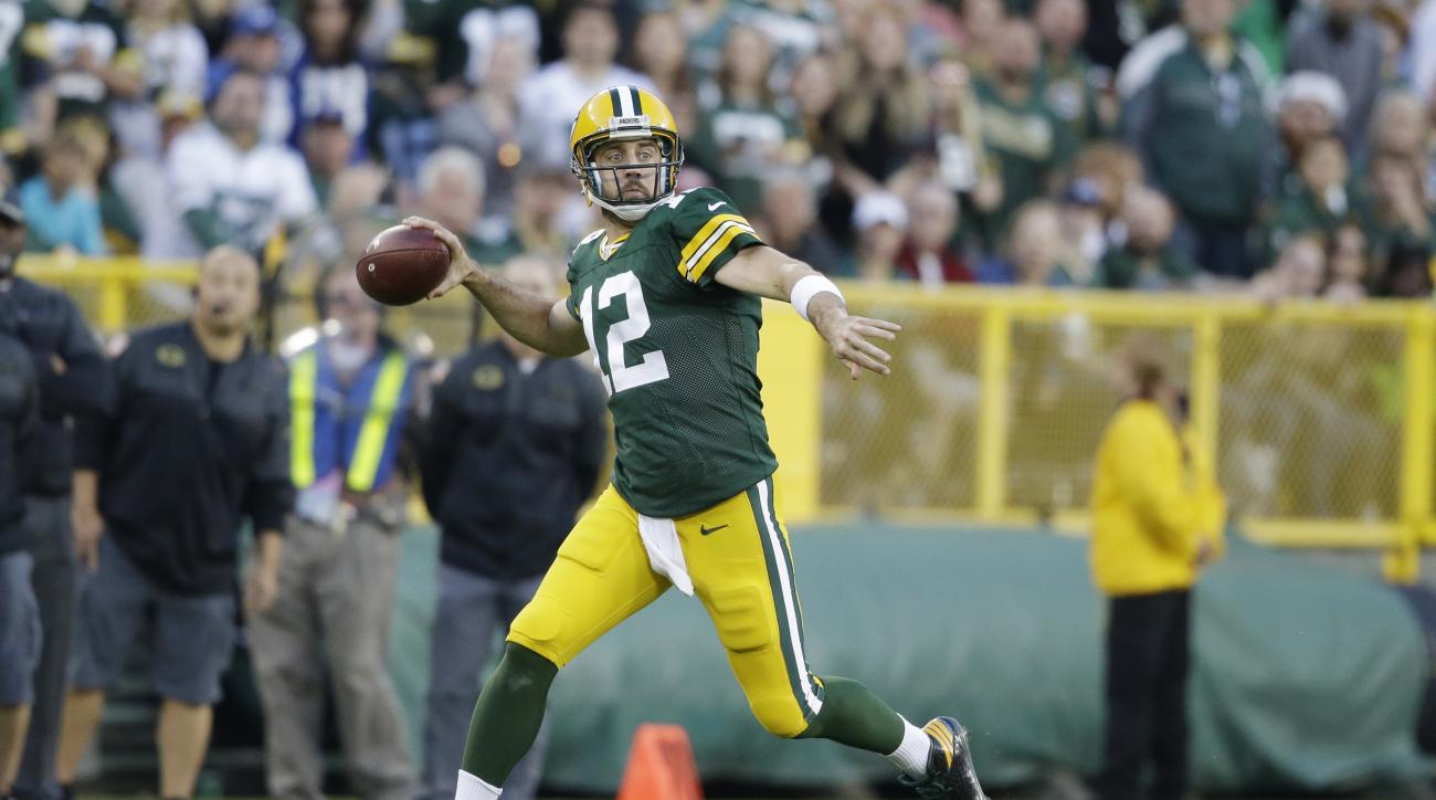 FILE - In this Nov. 6, 2016, file photo, Green Bay Packers' Aaron Rodgers throws during the first half of an NFL football game against the Indianapolis Colts, in Green Bay, Wis. The Packers need to beat the Seahawks Sunday to keep pace with first-place De