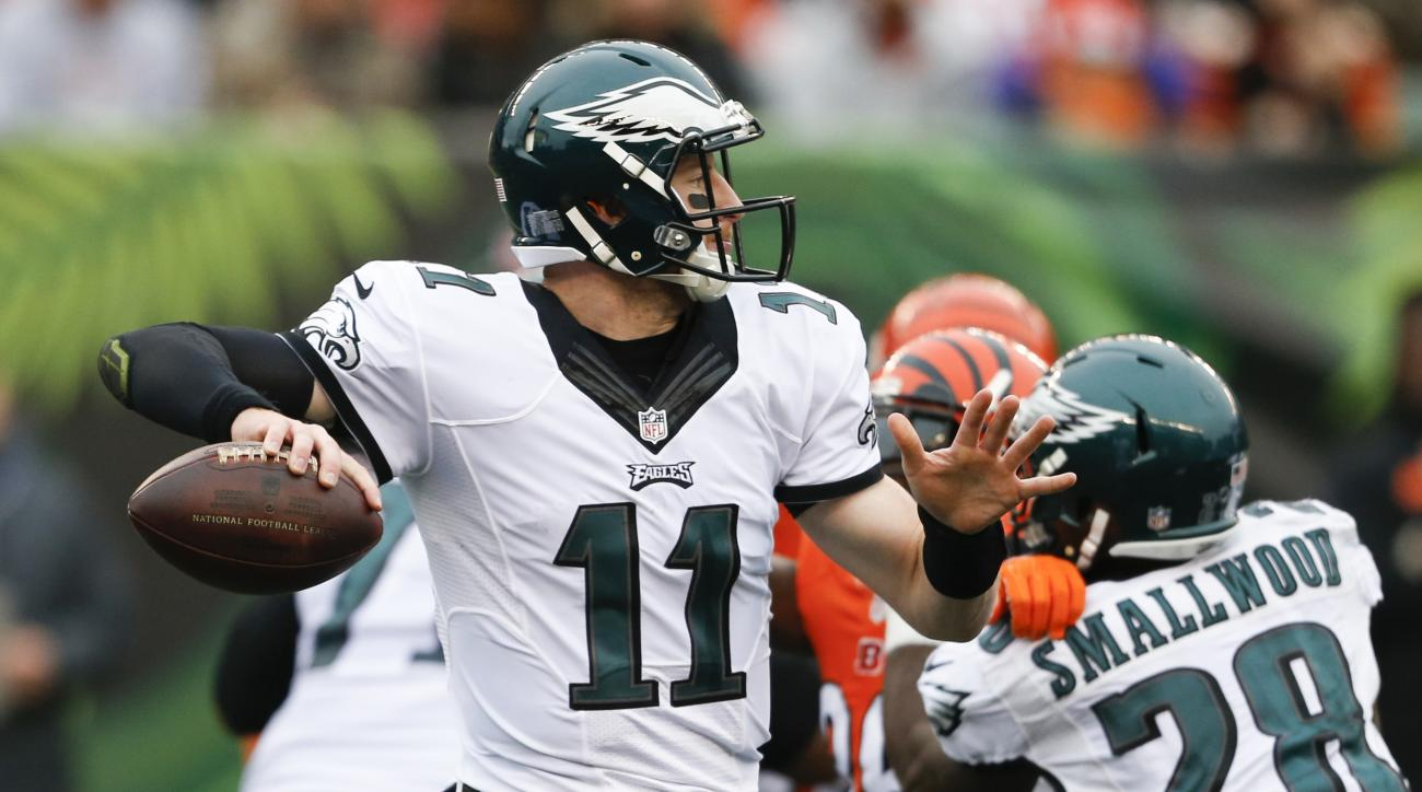 FILE - In this Sunday, Dec. 4, 2016 file photo, Philadelphia Eagles quarterback Carson Wentz passes in the first half of an NFL football game against the Cincinnati Bengals in Cincinnati. That 3-0 start for Carson Wentz and Philadelphia is a distant memor