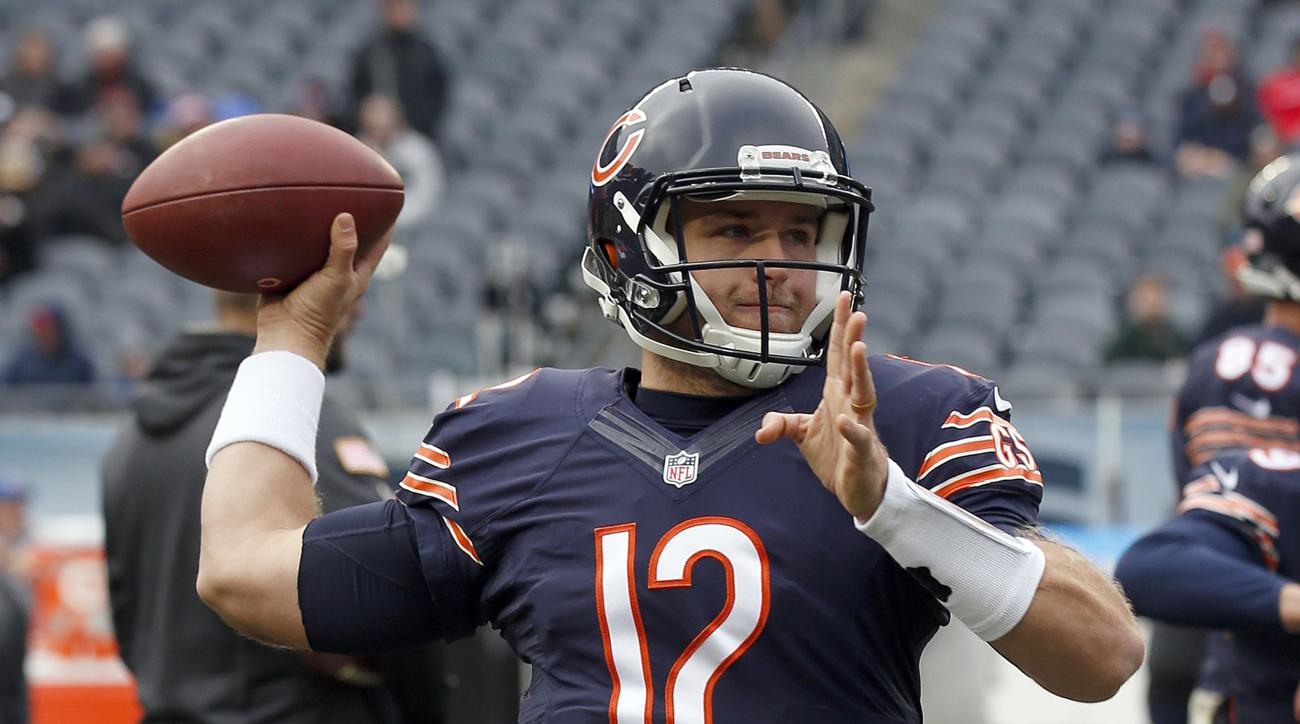 FILE - In this Sunday, Nov. 27, 2016 file photo, Chicago Bears quarterback Matt Barkley (12) warms up before an NFL football game against the Tennessee Titans in Chicago. Chicago Bears quarterback Matt Barkley likened his return to playing football regula