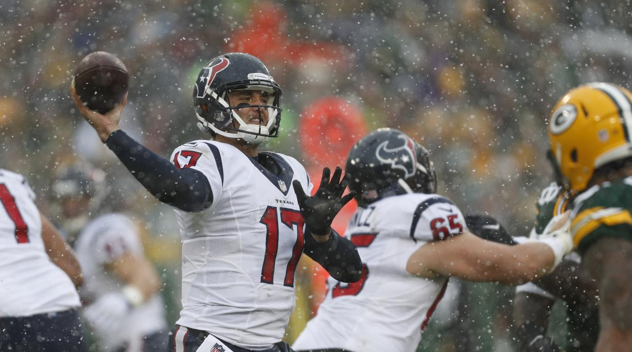 In this Sunday, Dec. 4, 2016, photo, Houston Texans' Brock Osweiler throws during the first half of an NFL football game against the Green Bay Packers in Green Bay, Wis. The Texans, headed to Indianapolis for a first-place showdown with the Colts after bl