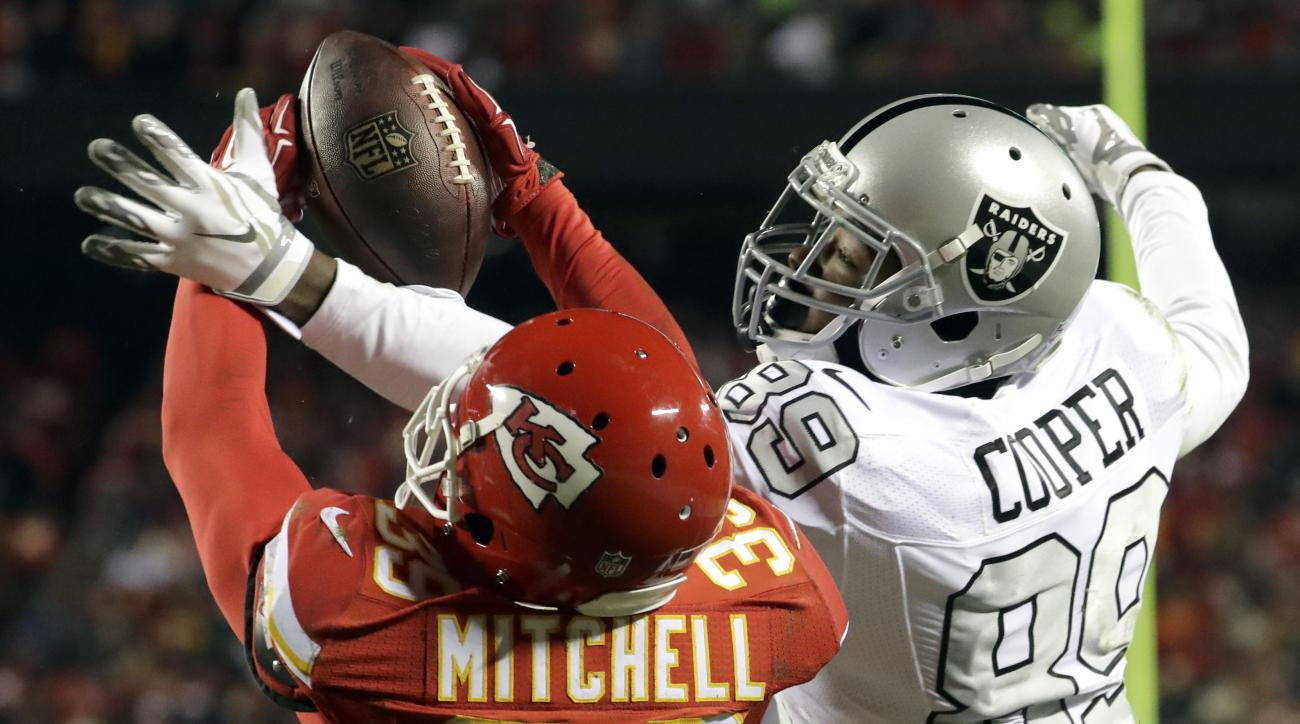 Kansas City Chiefs defensive back Keith McGill II (39) nearly intercepts a pass intended for Oakland Raiders wide receiver Amari Cooper (89) during the first half of an NFL football game in Kansas City, Mo., Thursday, Dec. 8, 2016. The pass was incomplete