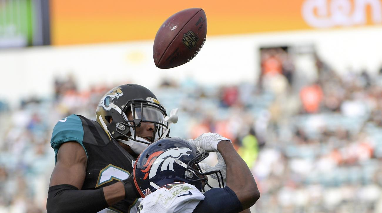 FILE - In this Sunday, Dec. 4, 2016, file photo, Jacksonville Jaguars cornerback Jalen Ramsey, left, breaks up a pass intended for Denver Broncos wide receiver Emmanuel Sanders during the second half of an NFL football game in Jacksonville, Fla. Ramsey an