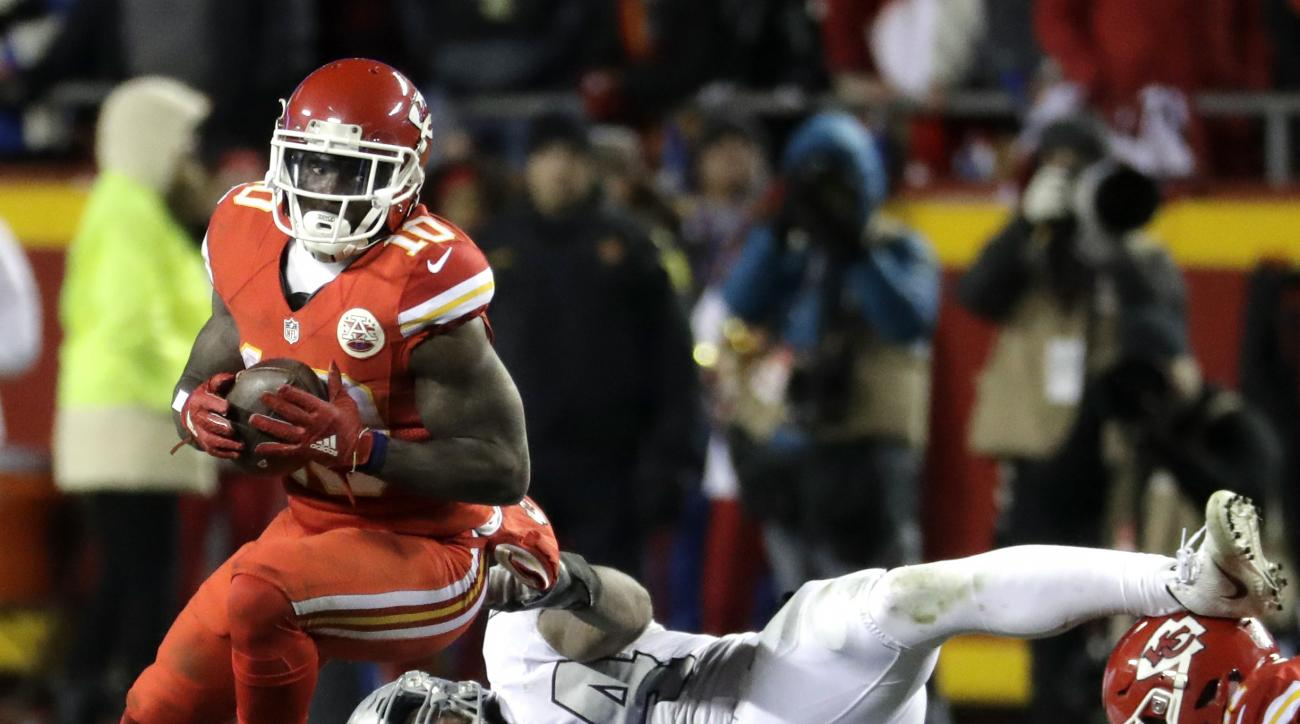 Kansas City Chiefs wide receiver Tyreek Hill (10) avoids a tackle attempt by Oakland Raiders linebacker Perry Riley (54) during the second half of an NFL football game in Kansas City, Mo., Thursday, Dec. 8, 2016. The Kansas City Chiefs won 21-13. (AP Phot