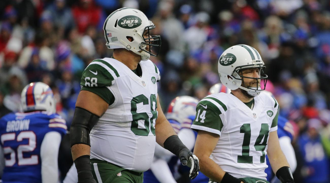 New York Jets quarterback Ryan Fitzpatrick (14) and Breno Giacomini (68) leave the field after Fitzpatrick fumbled the ball during the first half of an NFL football game against the Buffalo Bills Sunday, Jan. 3, 2016, in Orchard Park, N.Y. (AP Photo/Bill