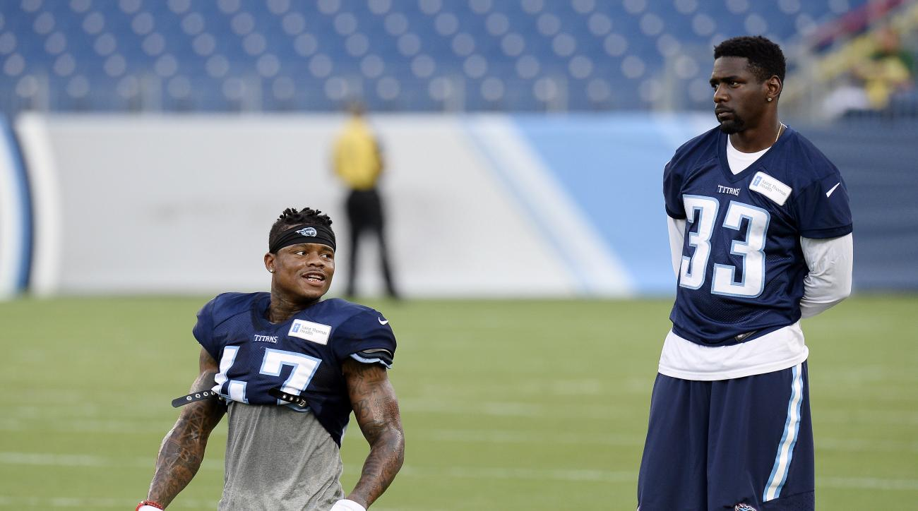 FILE - In this Aug. 8, 2016, file photo, Tennessee Titans' Antwon Blake (47) and Brice McCain (33) talk during a scrimmage at NFL football training camp scrimmage in Nashville, Tenn.  The Titans have had two weeks since releasing veteran Perrish Cox to fi