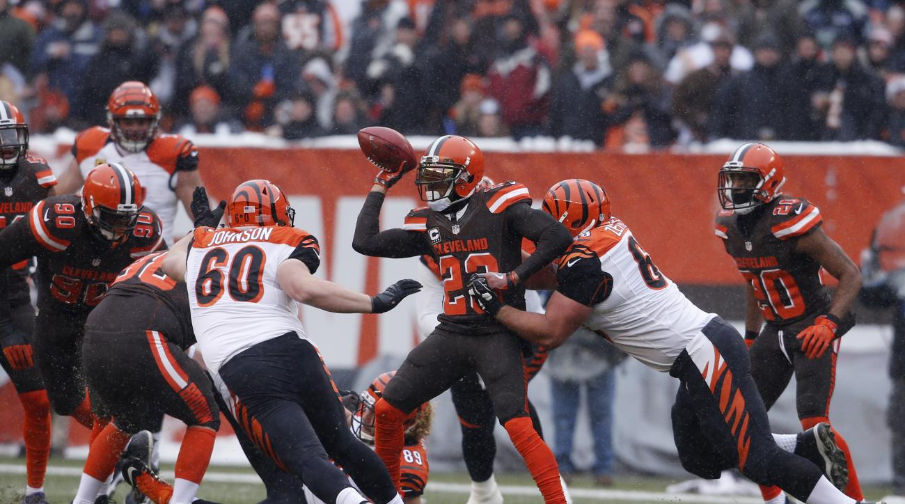 Cleveland Browns cornerback Joe Haden (23) attempts a lateral after a blocked extra point in the first half of an NFL football game against the Cincinnati Bengals, Sunday, Dec. 11, 2016, in Cleveland. (AP Photo/Ron Schwane)