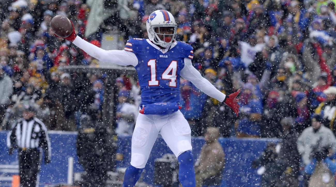 As snow falls, Buffalo Bills wide receiver Sammy Watkins (14) celebrates after scoring on a touchdown pass from quarterback Tyrod Taylor against the Pittsburgh Steelers during the first half of an NFL football game, Sunday, Dec. 11, 2016, in Orchard Park,