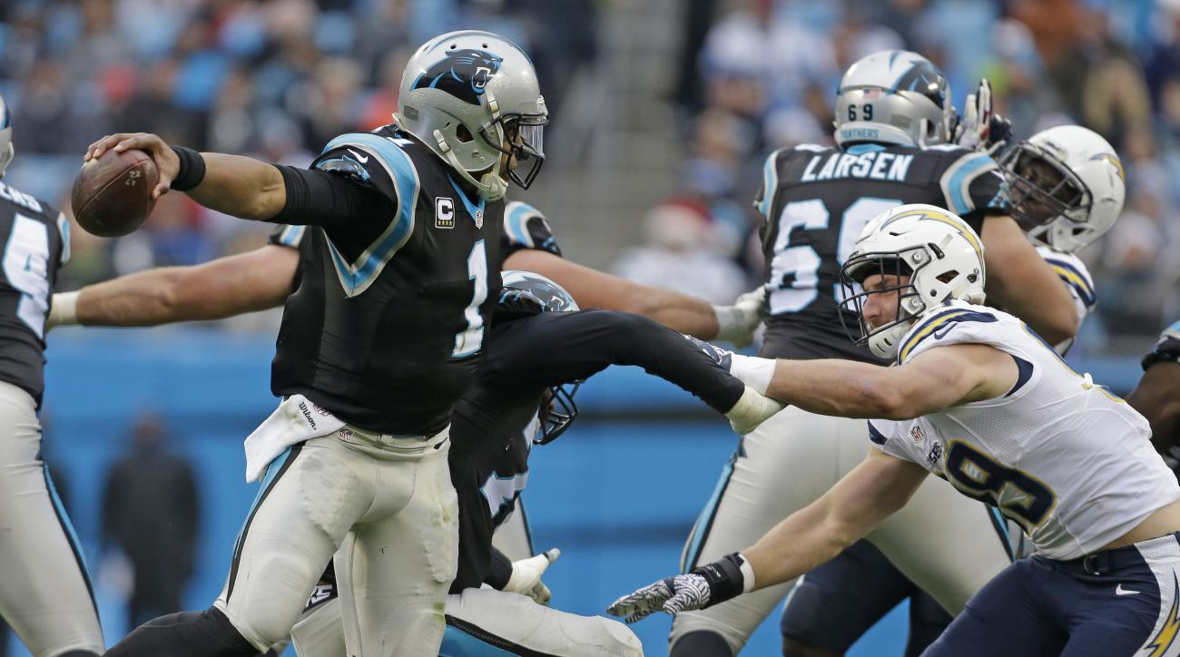 Carolina Panthers' Cam Newton (1) tries to avoid San Diego Chargers' Joey Bosa (99) in the first half of an NFL football game in Charlotte, N.C., Sunday, Dec. 11, 2016. (AP Photo/Bob Leverone)