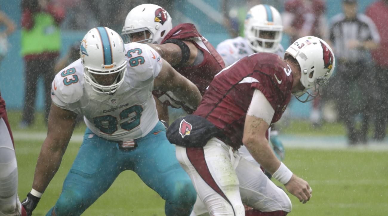 Arizona Cardinals quarterback Carson Palmer (3) fumbles the ball as Miami Dolphins defensive tackle Ndamukong Suh (93) attempts to recover it, during the first half of an NFL football game, Sunday, Dec. 11, 2016, in Miami Gardens, Fla. (AP Photo/Wilfredo