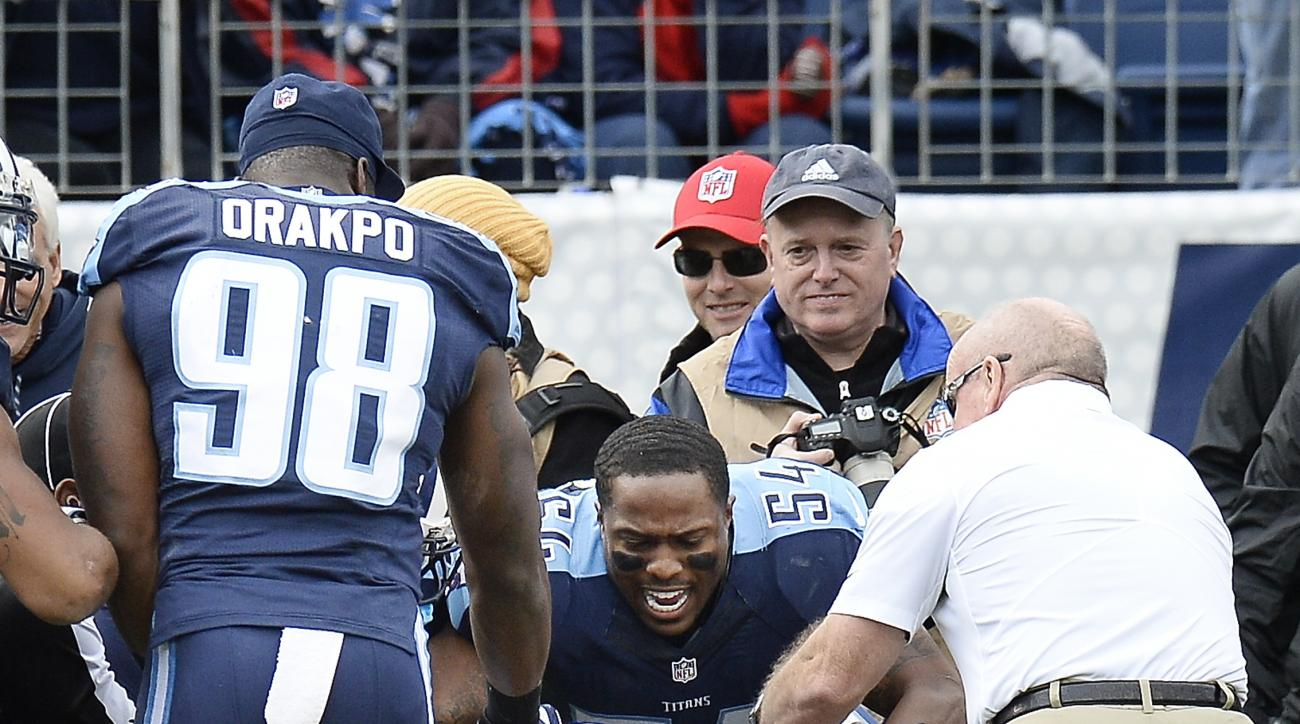 Tennessee Titans linebacker Avery Williamson (54) battles with Denver Broncos cornerback Aqib Talib (21) during a scuffle in the first half of an NFL football game Sunday, Dec. 11, 2016, in Nashville, Tenn. (AP Photo/Mark Zaleski)