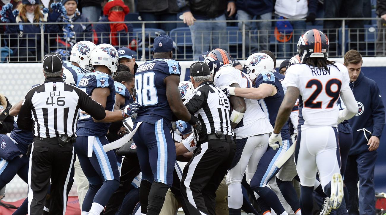 Tennessee Titans and Denver Broncos players push and shove during a scuffle in the first half of an NFL football game Sunday, Dec. 11, 2016, in Nashville, Tenn. (AP Photo/Mark Zaleski)