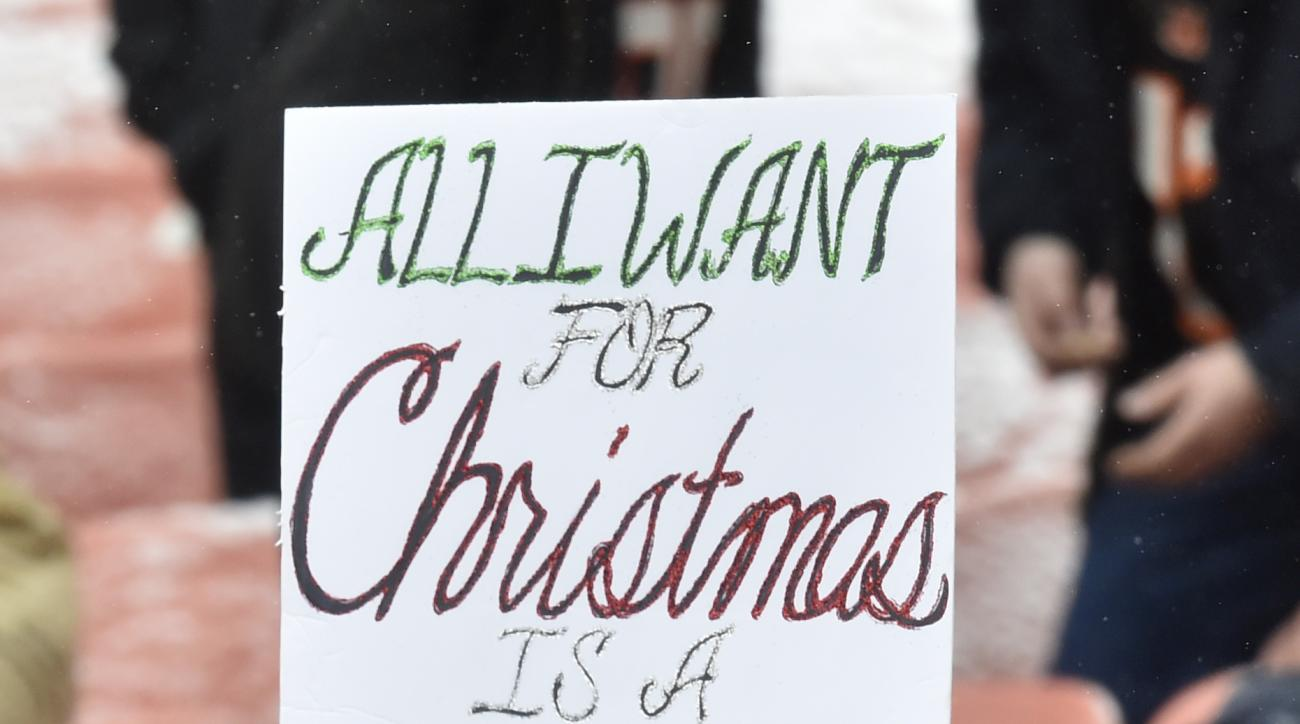 A Cleveland Browns fan holds up a sign in the second half of an NFL football game between the Cincinnati Bengals and the Browns, Sunday, Dec. 11, 2016, in Cleveland. (AP Photo/David Richard)