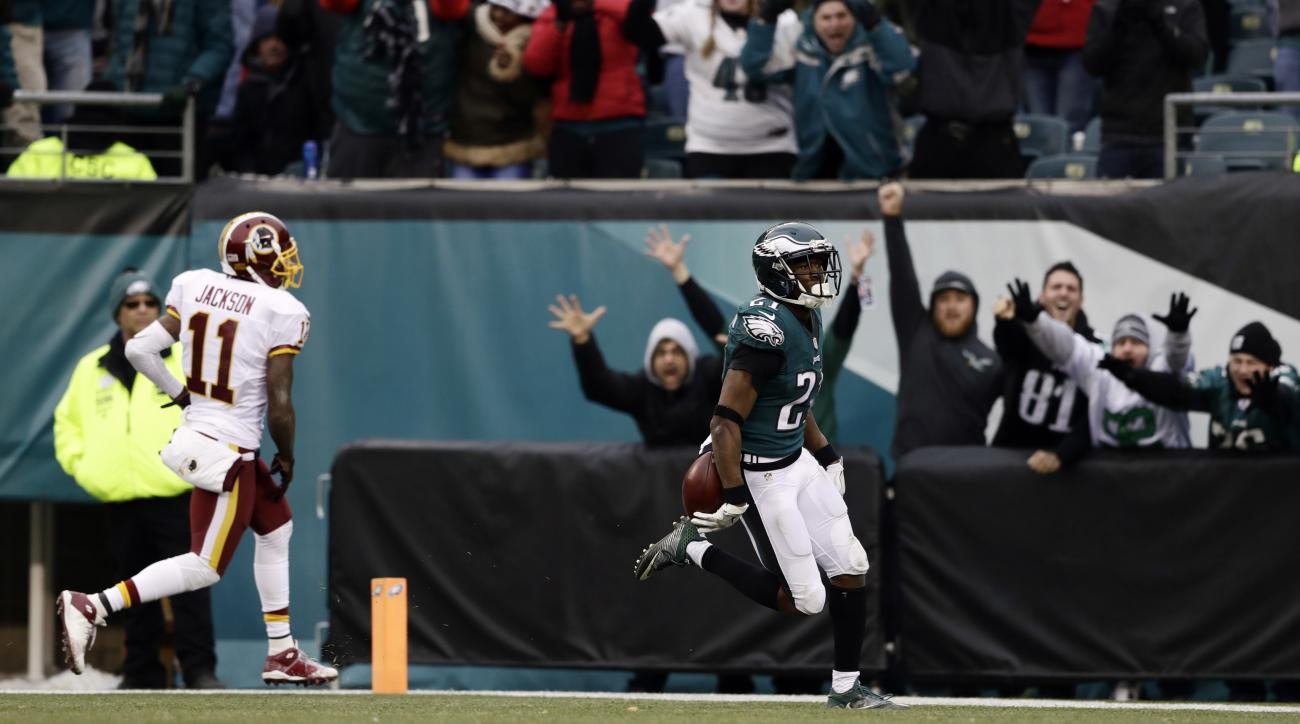 Philadelphia Eagles' Leodis McKelvin, right, scores a touchdown after intercepting a pass intended for Washington Redskins' DeSean Jackson (11) during the second half of an NFL football game, Sunday, Dec. 11, 2016, in Philadelphia. (AP Photo/Matt Rourke)