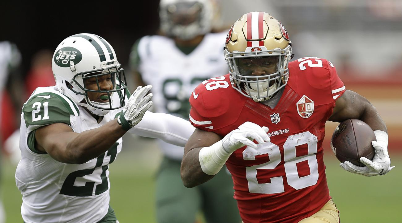 San Francisco 49ers running back Carlos Hyde (28) runs against New York Jets free safety Marcus Gilchrist (21) during the first half of an NFL football game in Santa Clara, Calif., Sunday, Dec. 11, 2016. (AP Photo/Ben Margot)