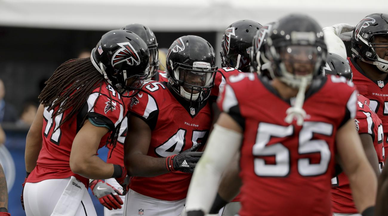 Atlanta Falcons middle linebacker Deion Jones (45) celebrates after scoring a touchdown on an interception against the Los Angeles Rams during the first half of an NFL football game Sunday, Dec. 11, 2016, in Los Angeles. (AP Photo/Rick Scuteri)