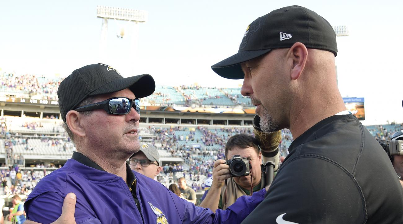 Minnesota Vikings head coach Mike Zimmer and Jacksonville Jaguars head coach Gus Bradley greet each other at the end of an NFL football game, Sunday, Dec. 11, 2016, in Jacksonville, Fla. Minnesota won 25-16. (AP Photo/Phelan M. Ebenhack)