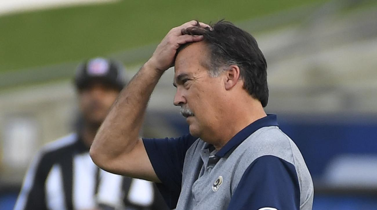 Los Angeles Rams head coach Jeff Fisher watches the first half of an NFL football game against the Atlanta Falcons, Sunday, Dec. 11, 2016, in Los Angeles. (AP Photo/Mark J. Terrill)