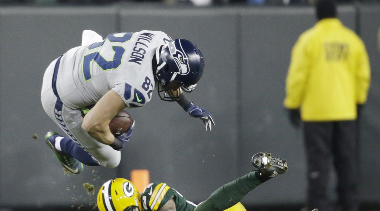 Green Bay Packers' Quinten Rollins tackles Seattle Seahawks' Luke Willson during the second half of an NFL football game Sunday, Dec. 11, 2016, in Green Bay, Wis. (AP Photo/Jeffrey Phelps)