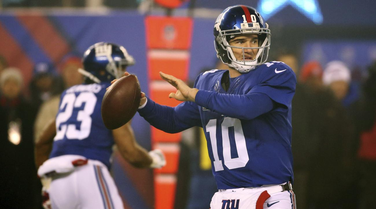 New York Giants quarterback Eli Manning (10) throws a pass during the first half of an NFL football game against the Dallas Cowboys, Sunday, Dec. 11, 2016, in East Rutherford, N.J. (AP Photo/Seth Wenig)