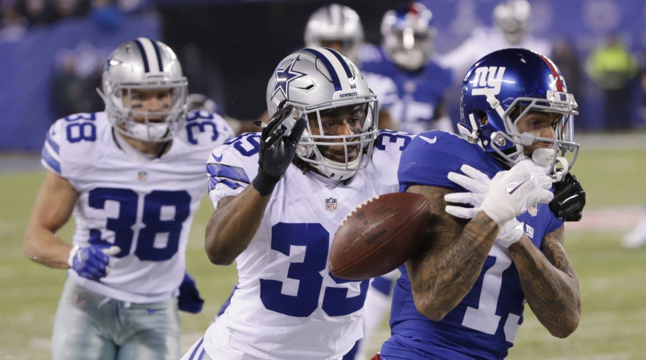 Dallas Cowboys cornerback Brandon Carr (39) breaks up a pass to New York Giants' Odell Beckham (13) during the first half of an NFL football game, Sunday, Dec. 11, 2016, in East Rutherford, N.J. (AP Photo/Seth Wenig)