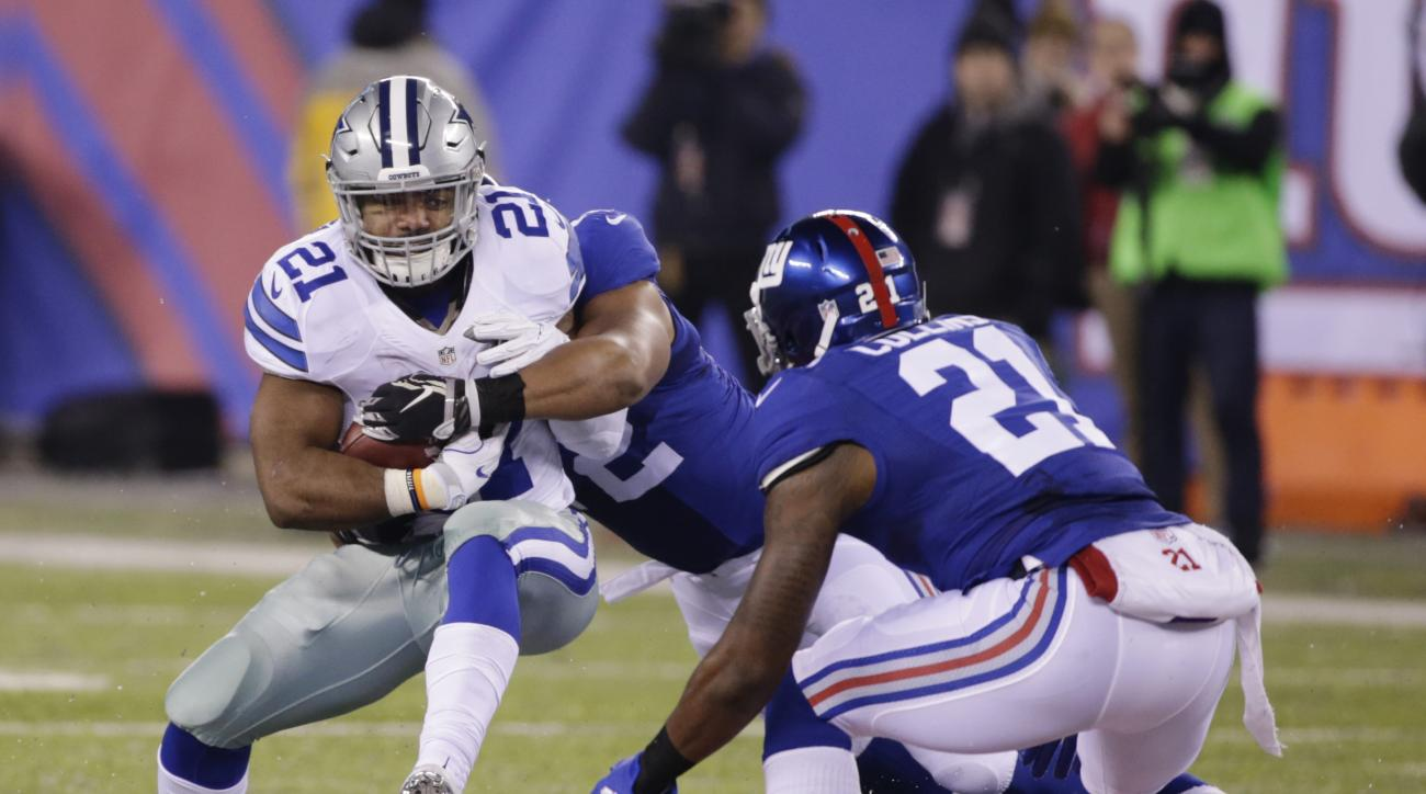 Dallas Cowboys running back Ezekiel Elliott (21) is tackled by New York Giants' Kerry Wynn (72) as Landon Collins (21) watches during the first half of an NFL football game, Sunday, Dec. 11, 2016, in East Rutherford, N.J. (AP Photo/Seth Wenig)