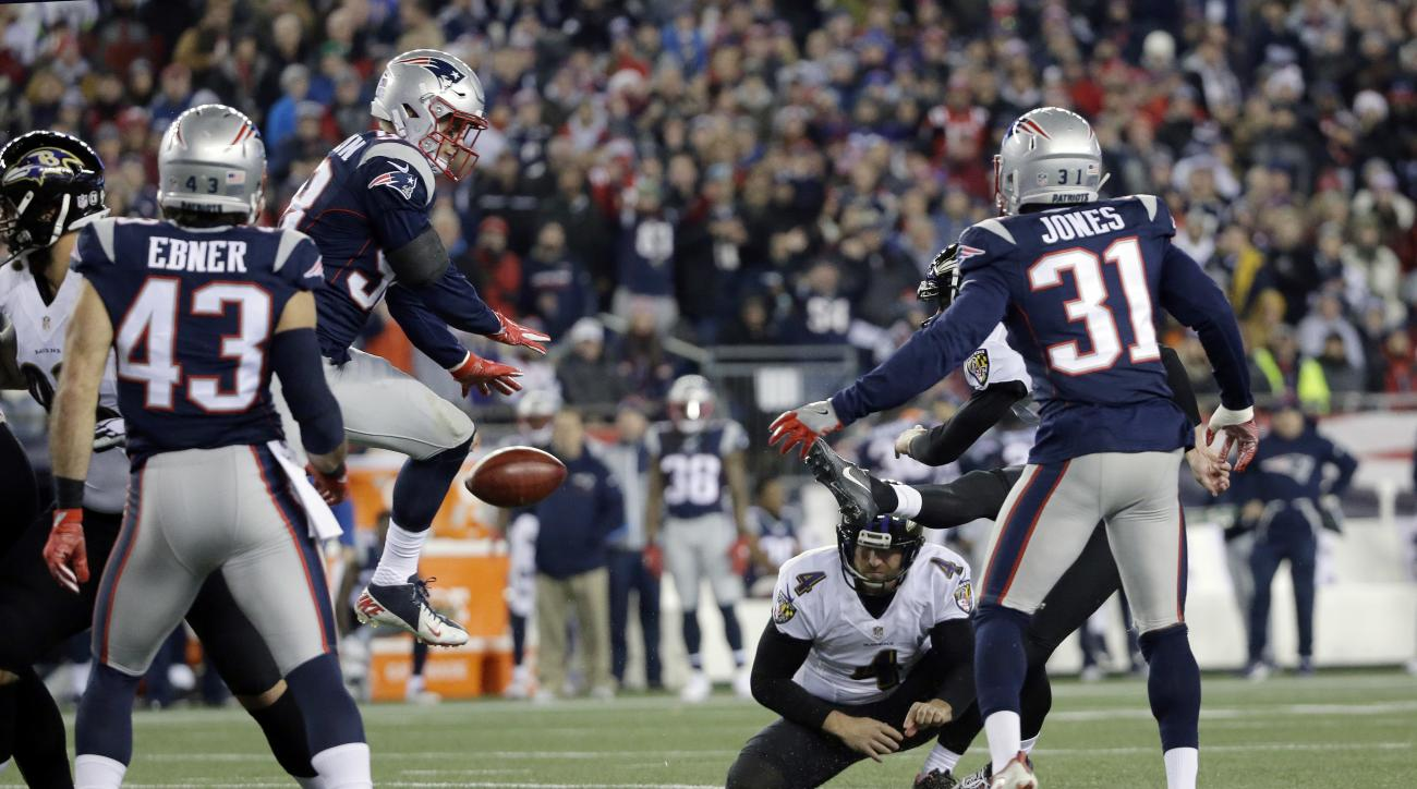 New England Patriots linebacker Shea McClellin (58) blocks a field goal attempt by Baltimore Ravens kicker Justin Tucker, partially hidden behind Patriots' Jonathan Jones (31), during the first half of an NFL football game, Monday, Dec. 12, 2016, in Foxbo