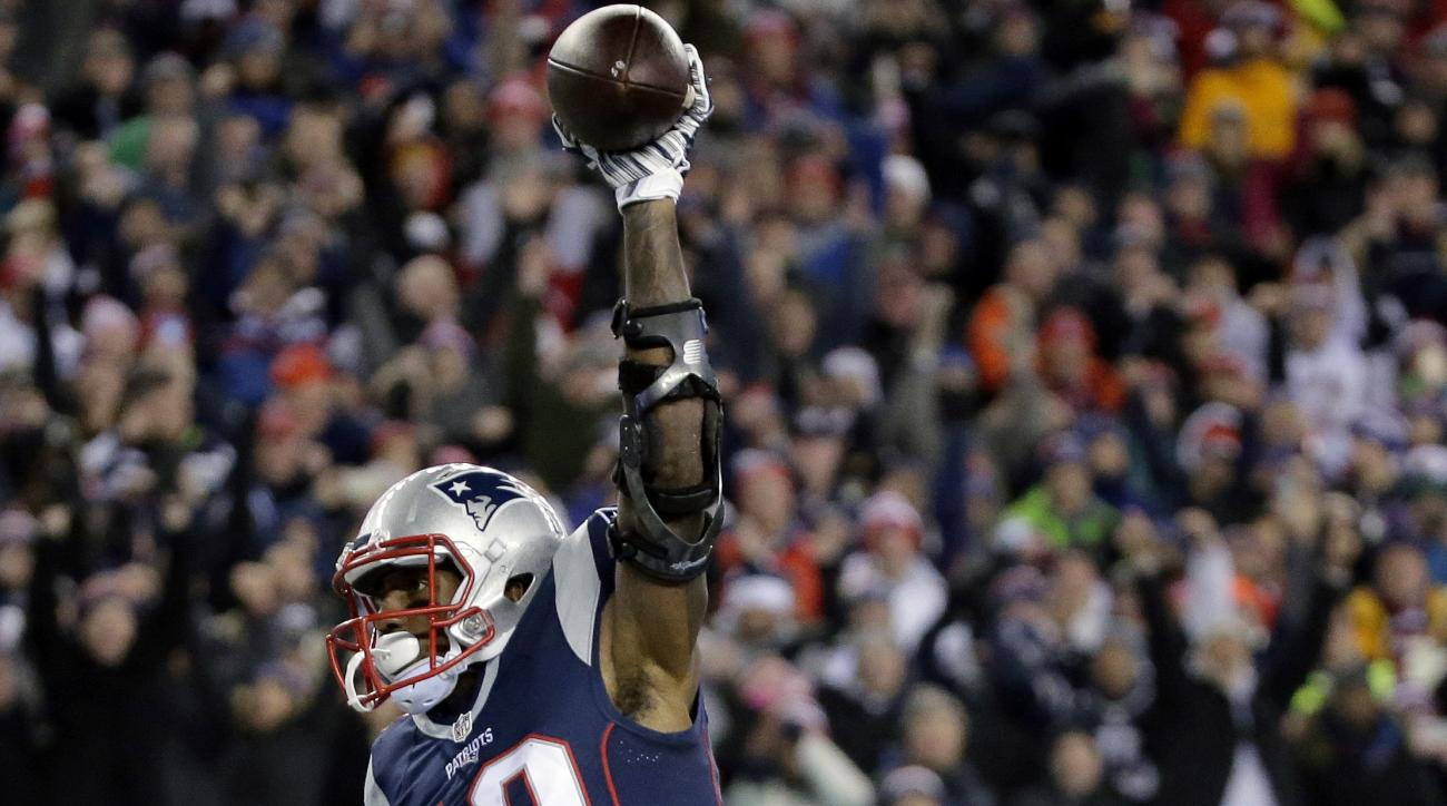 New England Patriots wide receiver Malcolm Mitchell celebrates his touchdown catch against the Baltimore Ravens during the first half of an NFL football game, Monday, Dec. 12, 2016, in Foxborough, Mass. (AP Photo/Steven Senne)