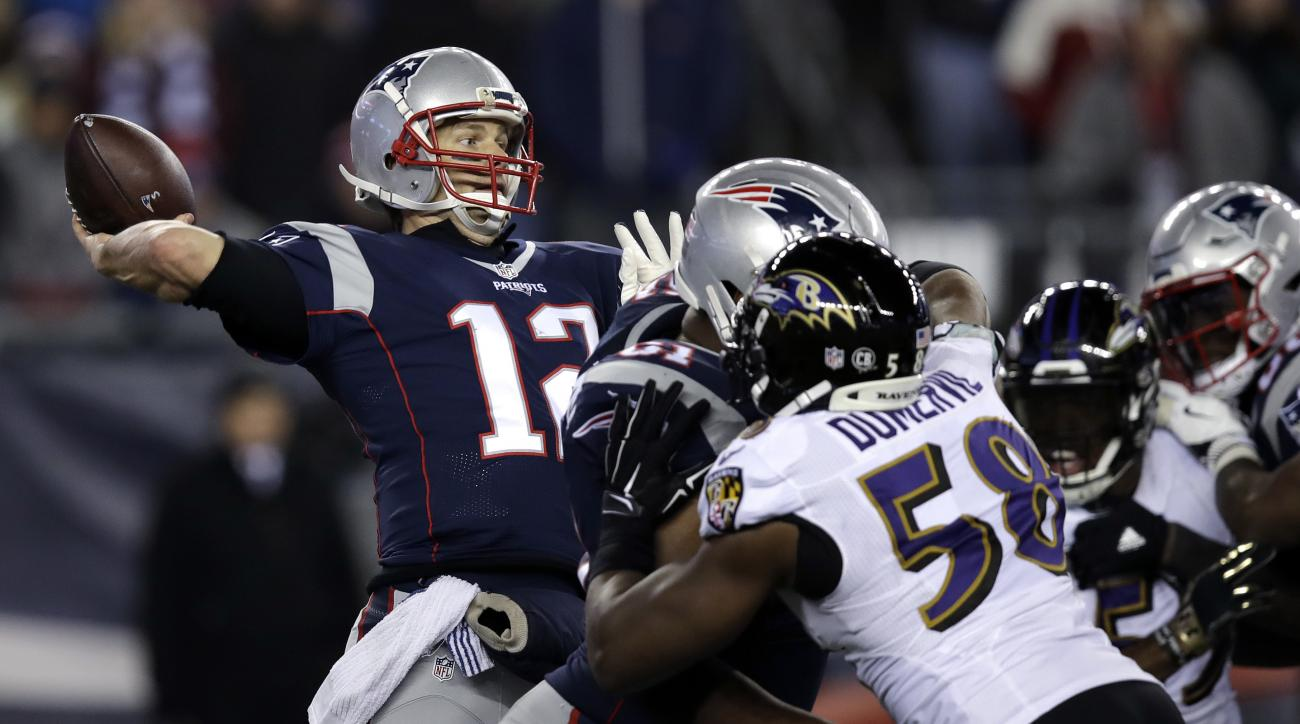 New England Patriots quarterback Tom Brady (12) throws a touchdown pass to Chris Hogan under pressure from Baltimore Ravens linebacker Elvis Dumervil (58) during the fourth quarter of an NFL football game, Monday, Dec. 12, 2016, in Foxborough, Mass. (AP P