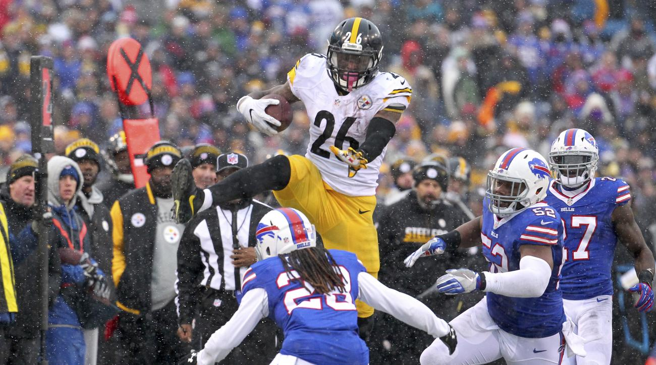 FILE - In this Dec. 11, 2016, file photo, Pittsburgh Steelers running back Le'Veon Bell (26) leaps over Buffalo Bills cornerback Ronald Darby (28) during the second half of an NFL football game, in Orchard Park, N.Y. The do-everything running back has thr
