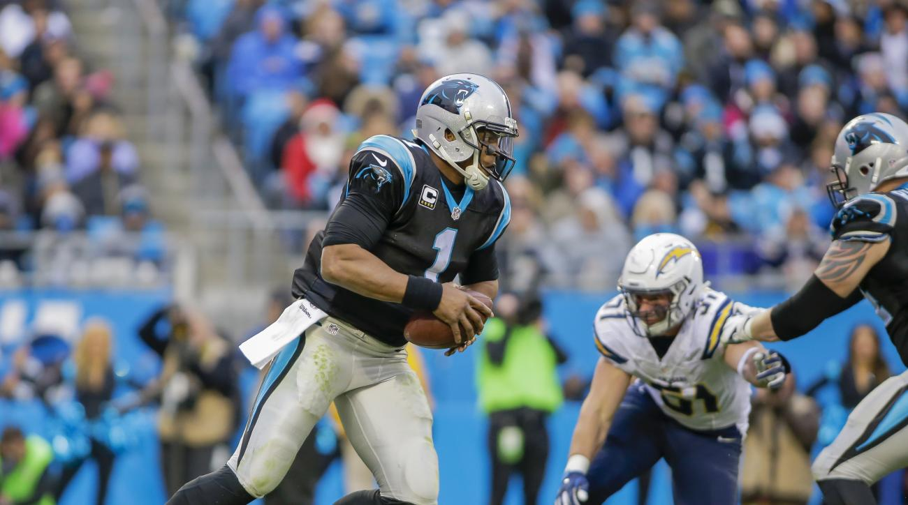 In this photo taken Dec. 11, 2016, Carolina Panthers' Cam Newton (1) looks for some running room against the San Diego Chargers during the second half of an NFL football game in Charlotte, N.C. Give up fewer points than you score is the name of the game,