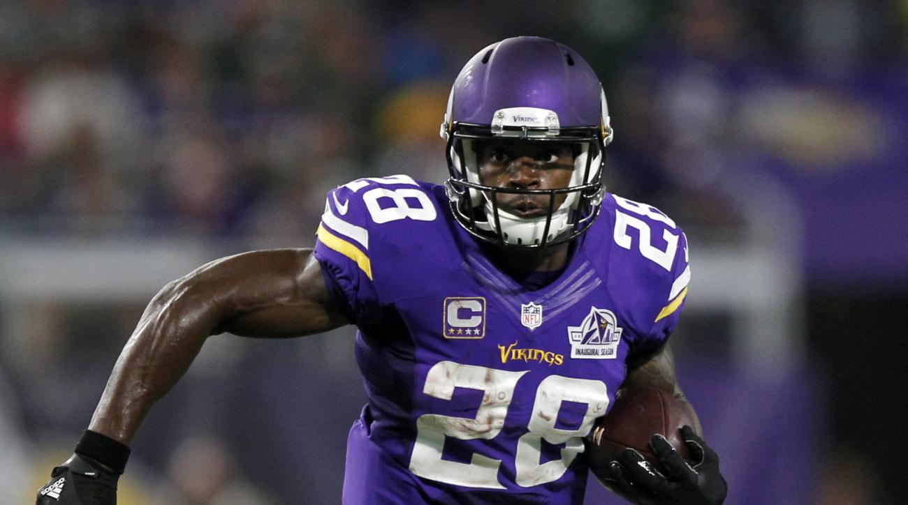 FILE - In this Sept. 18, 2016, file photo, Minnesota Vikings running back Adrian Peterson carries the ball during the first half of an NFL football game against the Green Bay Packers, in Minneapolis. Peterson is returning to practice this week for the Vik