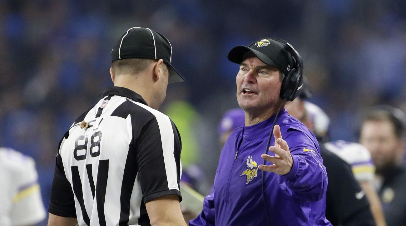 FILE - In this Thursday, Nov. 24, 2016 file photo, Minnesota Vikings head coach Mike Zimmer talks with field judge Brad Freeman during the second half of an NFL football game against the Detroit Lions in Detroit. From Aaron Rodgers to Eli Manning, Cam New
