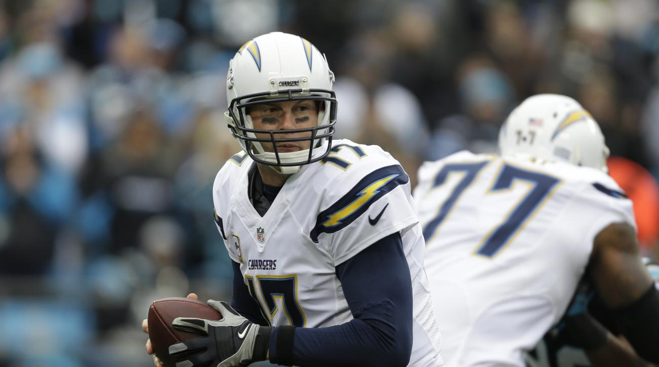 FILE - In a  Sunday Dec. 11, 2016 file photo, San Diego Chargers' Philip Rivers (17) looks to pass against the Carolina Panthers in the first half of an NFL football game in Charlotte, N.C.  It could be a remarkable scene Sunday, Dec. 18, 2016 when the Oa