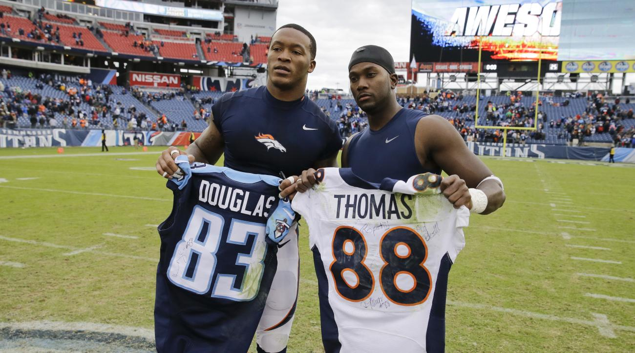 FILE - In this Dec. 11, 2016, file photo, Denver Broncos wide receiver Demaryius Thomas, left, and Tennessee Titans wide receiver Harry Douglas, right, trade jerseys after an NFL football game in Nashville, Tenn. Thomas said Thursday, Dec. 15, 2016, he di