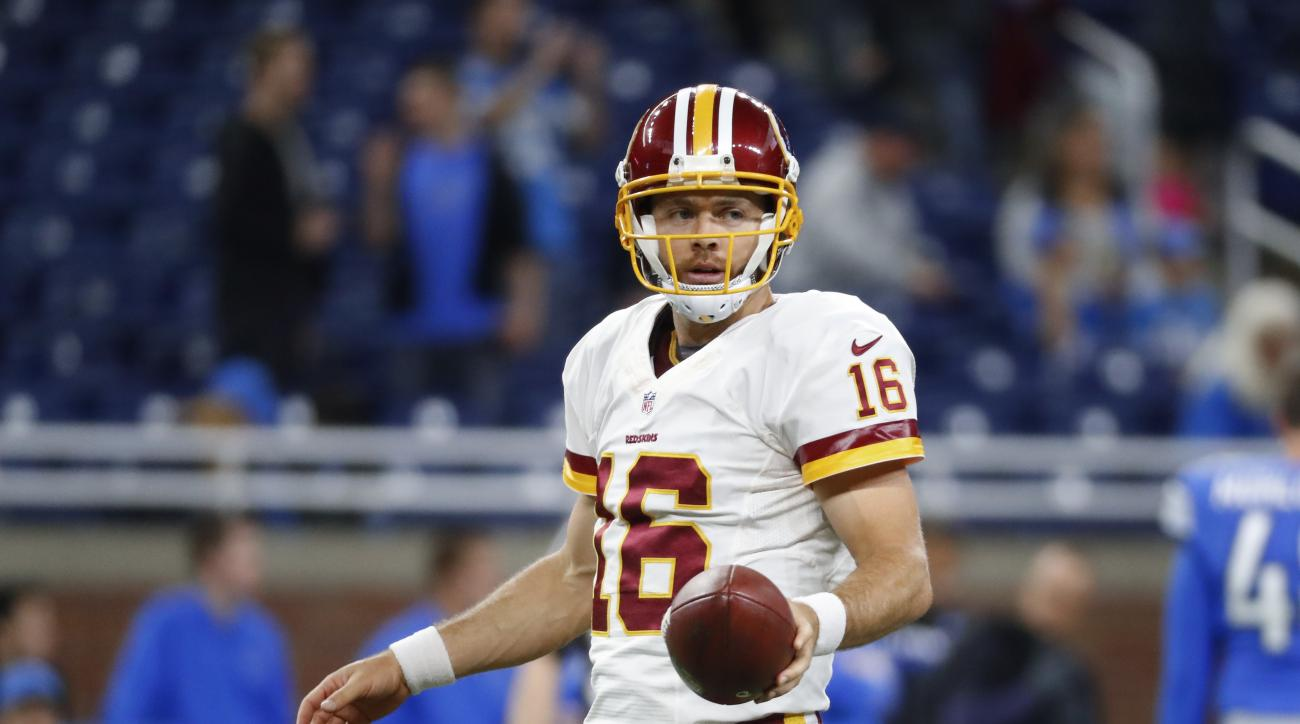 FILE - In this Oct. 24, 2016, file photo, Washington Redskins quarterback Colt McCoy (16) warms up before an NFL football game against the Detroit Lions in Detroit. Quarterback Colt McCoy is the emergency long snapper for the Redskins, who watched the Eag