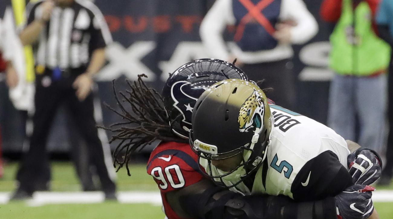 Jacksonville Jaguars quarterback Blake Bortles (5) is hit by Houston Texans defensive back Don Jones (20) during the first half of an NFL football game Sunday, Dec. 18, 2016, in Houston. (AP Photo/David J. Phillip)