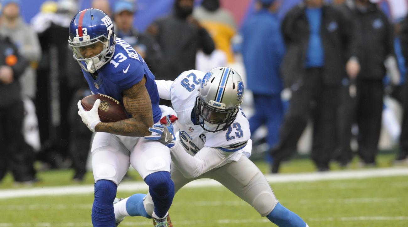 Detroit Lions cornerback Darius Slay (23) tackles New York Giants' Odell Beckham (13) during the first half of an NFL football game Sunday, Dec. 18, 2016, in East Rutherford, N.J. (AP Photo/Bill Kostroun)