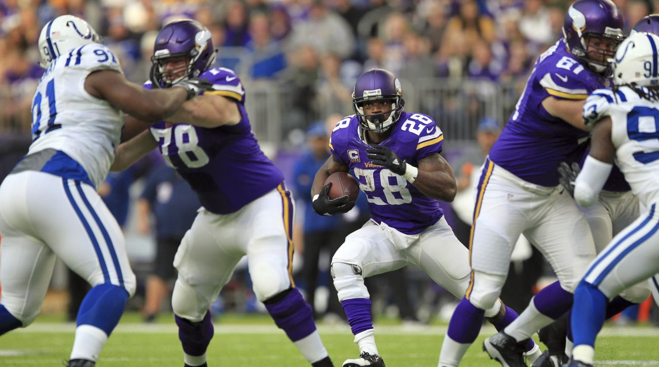 Minnesota Vikings running back Adrian Peterson (28) runs with the ball during the second half of an NFL football game against the Indianapolis Colts Sunday, Dec. 18, 2016, in Minneapolis. (AP Photo/Andy Clayton-King)