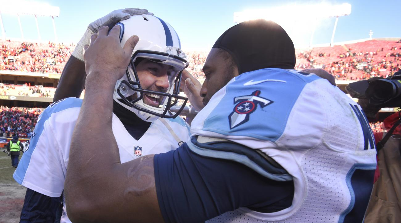 Tennessee Titans kicker Ryan Succop, left, is congratulated by linebacker Wesley Woodyard (59) after making the winning field goal during the second half of an NFL football game against the Kansas City Chiefs in Kansas City, Mo., Sunday, Dec. 18, 2016. (A