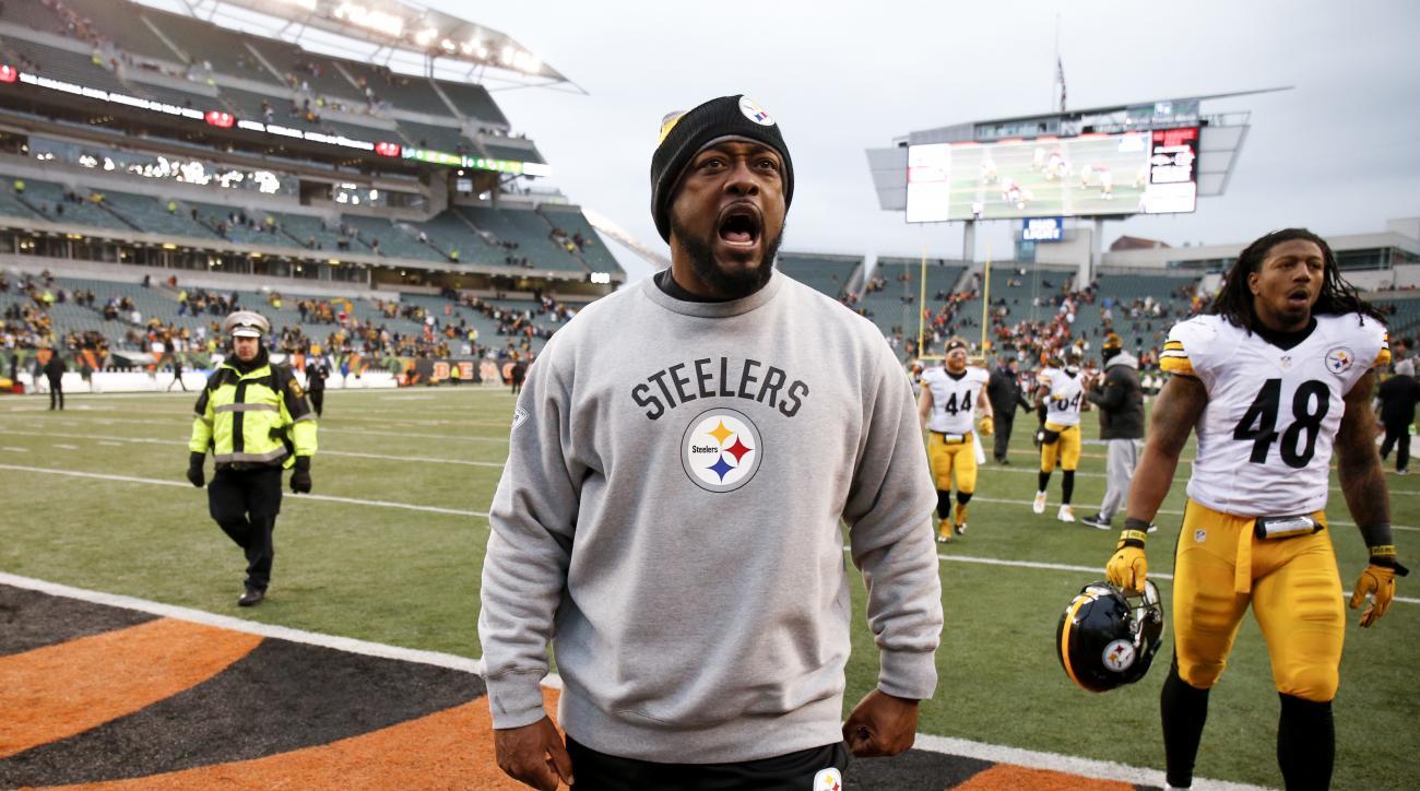 Pittsburgh Steelers head coach Mike Tomlin reacts after winning an NFL football game against the Cincinnati Bengals, Sunday, Dec. 18, 2016, in Cincinnati. (AP Photo/Gary Landers)