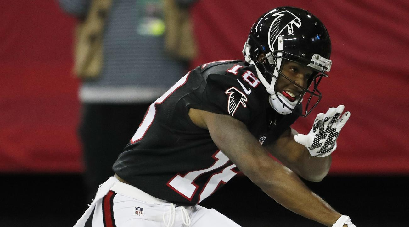 Atlanta Falcons wide receiver Taylor Gabriel (18) celebrates his touchdown against the San Francisco 49ers during the first half of an NFL football game, Sunday, Dec. 18, 2016, in Atlanta. (AP Photo/John Bazemore)